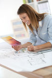 Woman architect choosing colors for decoration Stock Photo