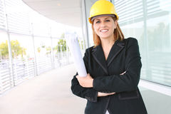 Woman Architect on Construction Site. A pretty woman architect on the building construction site Royalty Free Stock Photography