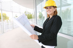Woman Architect on Construction Site. A pretty woman architect on the building construction site Stock Photo