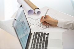 Woman Architect drawing on print  construction project Royalty Free Stock Photo