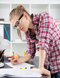 Woman architect drawing sketch Stock Images