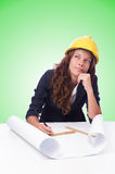 Woman architect with drawings against gradient Royalty Free Stock Image