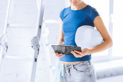 Woman architect with helmet and blueprint Royalty Free Stock Photography