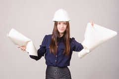 Woman architect in helmet broke drawing Stock Image