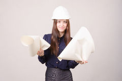 Woman architect in helmet drawing tears Stock Photos
