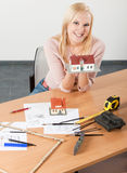 Woman architect at her work table Stock Photos