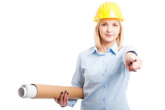 Woman architect holding blueprints and pointing Stock Photos