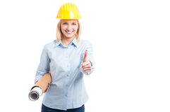 Woman architect holding blueprints showing thumb up Stock Images