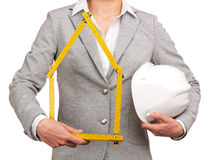 Woman architect holding a meter and a helmet Royalty Free Stock Images