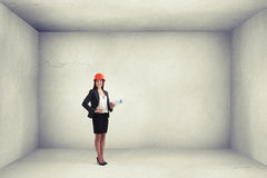 Woman architect holding plan Royalty Free Stock Photography