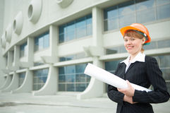 Woman architect holding roll Royalty Free Stock Photo