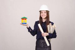 Woman architect with a house worth and drawing in hands Stock Photography