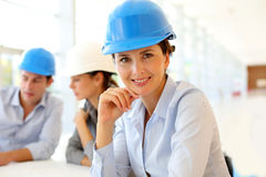 Woman architect in office. Portrait of attractive architect wearing security helmet Stock Photography