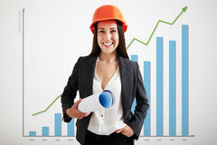 Woman architect over graph Royalty Free Stock Image