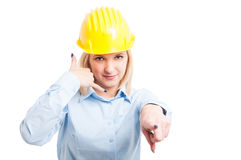 Woman architect pointing and showing call me gesture Stock Photo