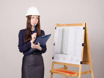 Woman architect on project thought of a multistory building Royalty Free Stock Image