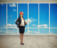 Woman architect in room with big windows Royalty Free Stock Image