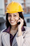 Woman architect talking on cellphone Royalty Free Stock Photography