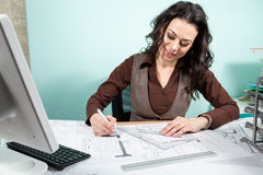 Woman architect working on blueprints. Working on new projects. Architecture and design Stock Photography