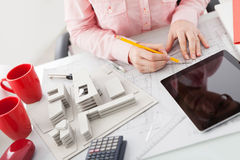 Woman architect working in an office Stock Images