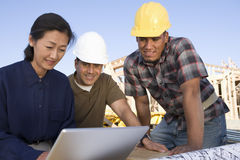 Woman With Architects Using Laptop royalty free stock photography