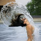 Woman and arcs of water in pool Royalty Free Stock Photos