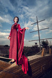 Woman in aristocratic clothes on boat Royalty Free Stock Image