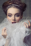 Woman with aristocratic romantic style. Close-up shoot of beauty adorned like aristocratic vintage dame with shiny tiara in the elegant hair-style, precious royalty free stock images