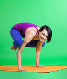 Woman arm balance funny yoga - color style cloth Royalty Free Stock Photos