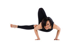 Woman arm balance yoga asana - leg in armpit Royalty Free Stock Photo