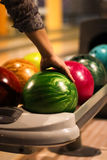 Woman arm and bowling ball Stock Photos