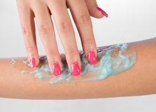 Woman arm with skin gel. Woman rubbing skin gel on her arm Royalty Free Stock Photos