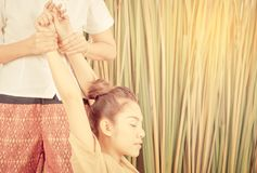 Woman arm in thai massage stretch position Stock Photos