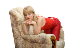 The woman in an armchair Royalty Free Stock Image