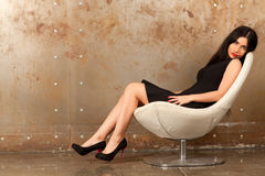 Woman in an armchair Stock Photo
