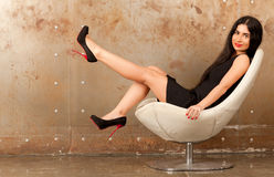 Woman in an armchair Stock Images