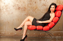 Woman in an armchair Stock Image