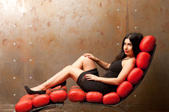 Woman in an armchair Royalty Free Stock Images