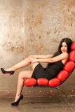 Woman in an armchair Royalty Free Stock Image