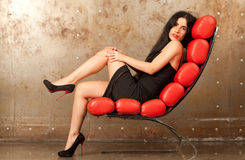 Woman in an armchair Stock Photography