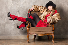 Woman in an armchair Royalty Free Stock Photography