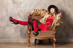 Woman in an armchair Royalty Free Stock Photos