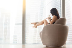 Woman in the armchair, profile view Royalty Free Stock Photography
