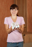 Woman with armful of    bulbs Stock Photography