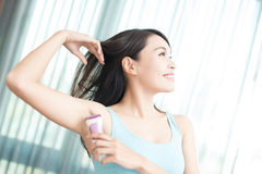 Woman with armpit plucking Royalty Free Stock Image