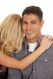 Woman arms around man close her hair his face Stock Images