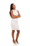 Woman with arms crossed. Beautiful african woman with arms crossed standing on white background Stock Photos