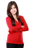 Woman with arms crossed and looking at camera Royalty Free Stock Images