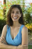Woman with Arms Crossed outdoors front view portrait. Royalty Free Stock Photography