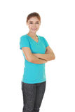 Woman with arms crossed, wearing t-shirt Stock Images